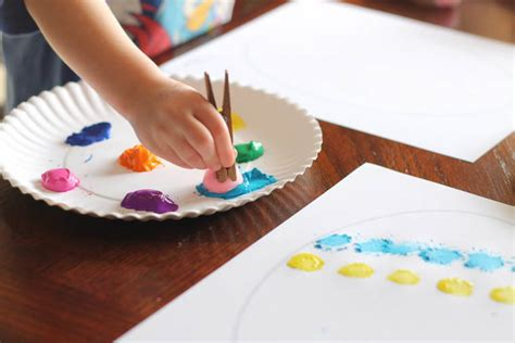 easy easter craft painting eggs easy easter craft painting eggs with pom pom balls
