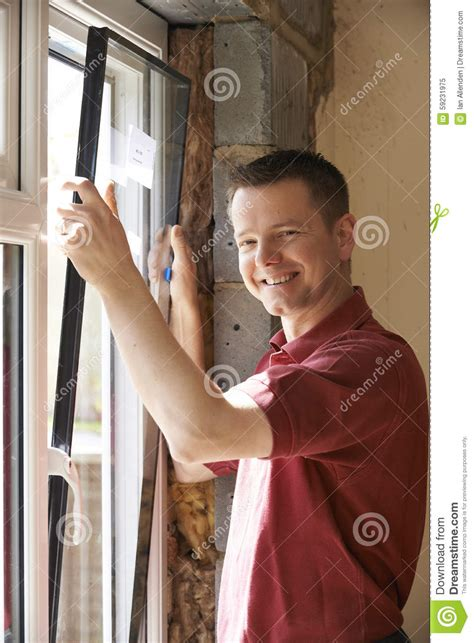 installing windows house construction worker installing new windows in house stock photo image 59231975
