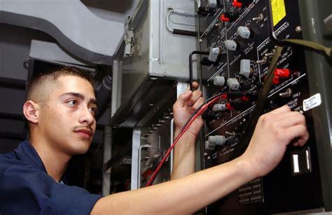 file us navy 020902 n 4953e 005 aviation electrician conducts a temperature controller test set