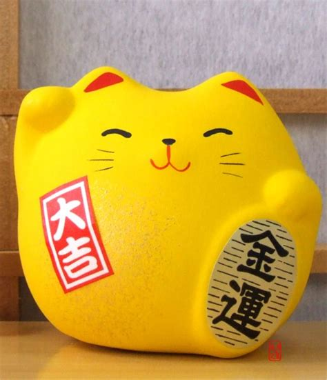 feng shui yellow maneki neko feng shui lucky yellow cat for good fortune in