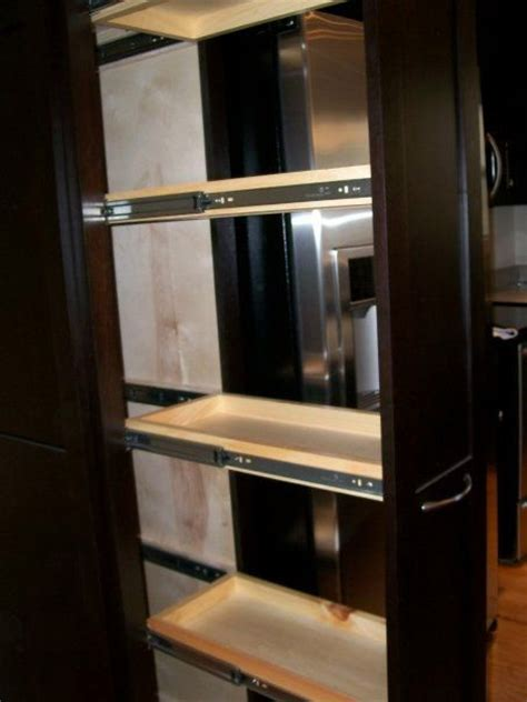 tall pull out kitchen cabinets 17 best images about unique custom cabinets on pinterest