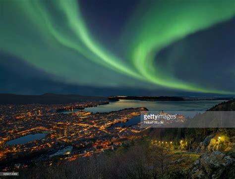 northern lights aurora borealis over harbor of bergen city