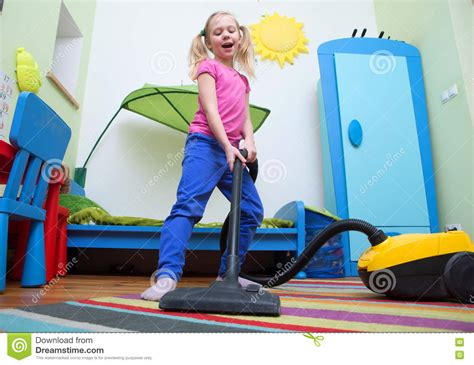 Hoovering The Floor by Cleaning Floor With Hoover Stock Photo Image 70183822