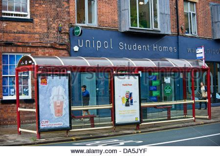 bus stop with lidl advert for england football shirts and