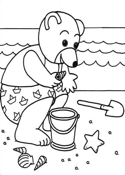 coloriage petit ours brun ramasse des coquillages