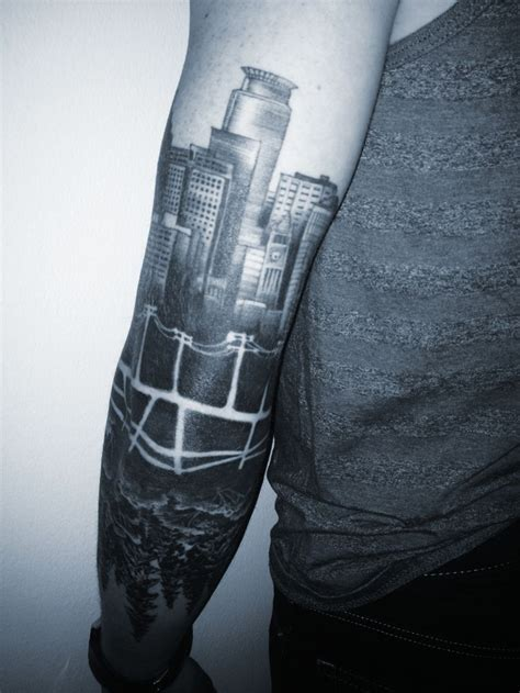 forearm forest tattoo minneapolis skyline reflected forest back of arm