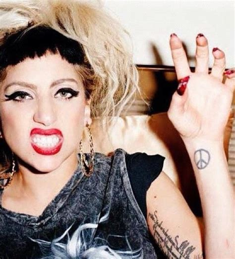 lady gaga arm tattoo gaga peace on wrist meaning of peace