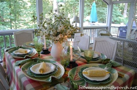summer table settings summer dining on the porch with corn on the cob and corn chargers