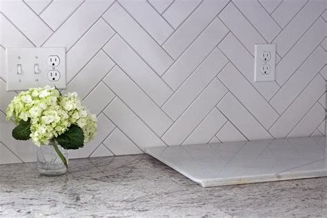 herringbone backsplash tile 1000 images about kitchen backsplash on
