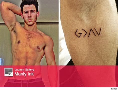 nick jonas tattoos nick jonas gets new god see the pic toofab