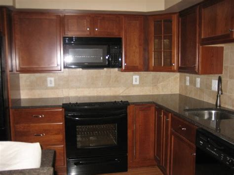 black stainless appliances with cherry cabinets cherry cabinets with black appliances for the home