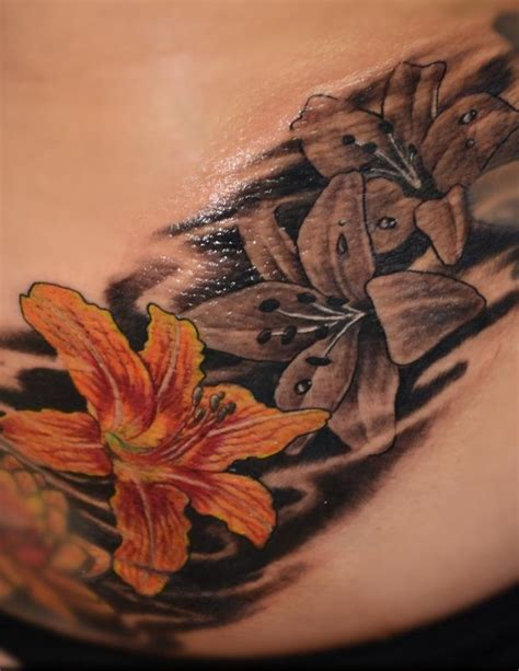 tattoo black and grey and color colorful and black and gray lillies by rafael marte