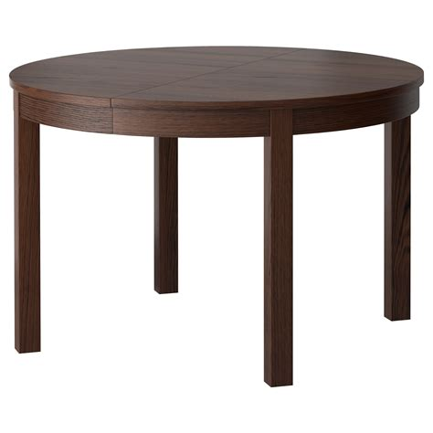 Round Brown Wooden Table With Four Legs Placed On The Dining Table With 4 Legs