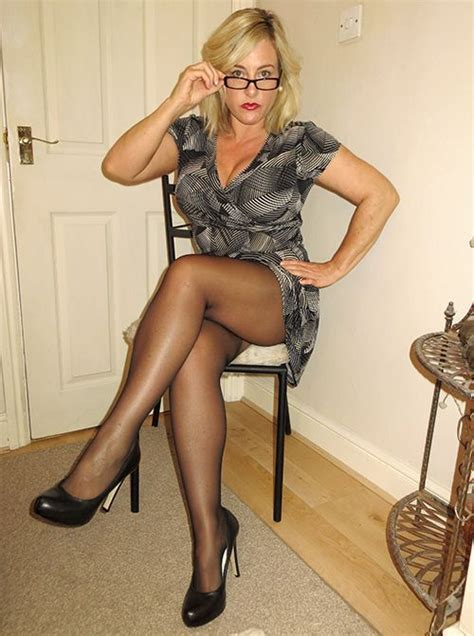 older mature topless heels sitting blond cheating wife wearing glasses abd a black and grey