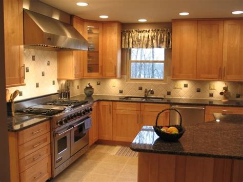 blue kitchen with oak cabinets tan brown sapphire blue granite counters with oak
