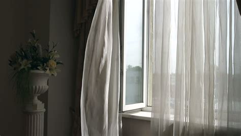 wind curtains curtain fluttering in the wind at the window wind at the
