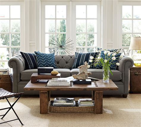 grey and blue sofa gray sofa with blue accent pillows and natural fiber rug