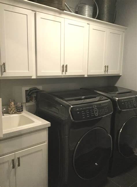 laundry room upper cabinets 7 columbus laundry room storage zones cabinet and