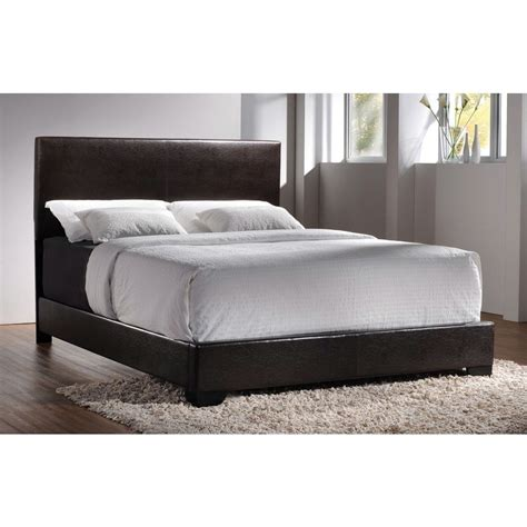 dark brown faux leather upholstered bed with headboard
