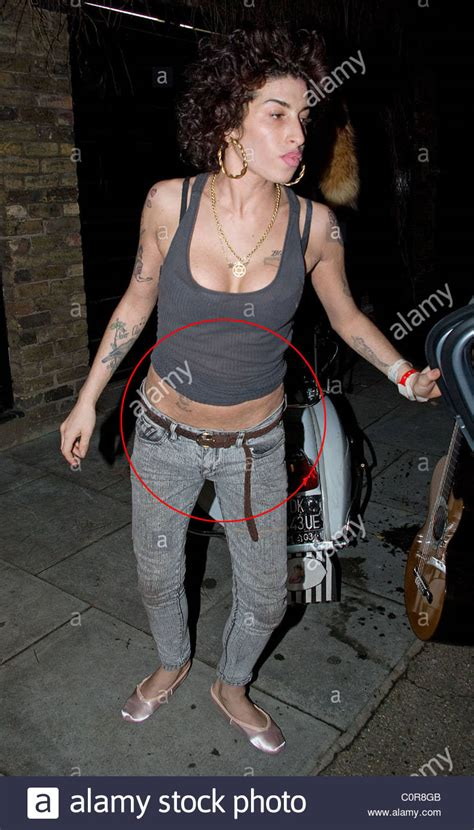 amy winehouse house amy winehouse steps out of her house to the taxi but then changes stock photo