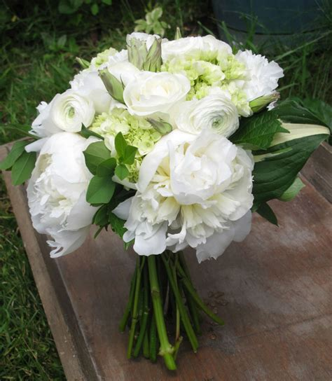 stunning pink peonies greens white roses centerpiece bouquet of white peonies roses ranunculus mini green