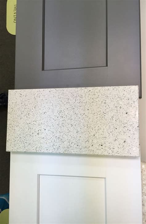 slate appliances with white cabinets echelon white and slate shaker cabinets ceasarstone