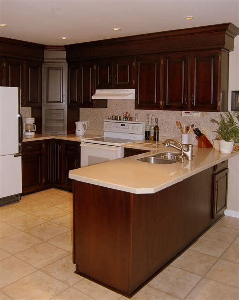 cherry cabinets black molding black crown molding cherry kitchen with two piece crown molding and paneling