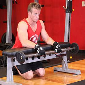 reverse wrist curl over bench palms down wrist curl over a bench exercise guide and video