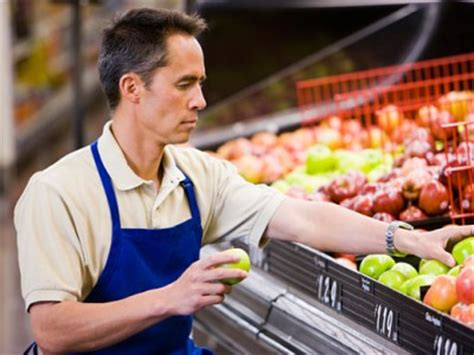 grocery clerk stock photo 1660r 40705 superstock