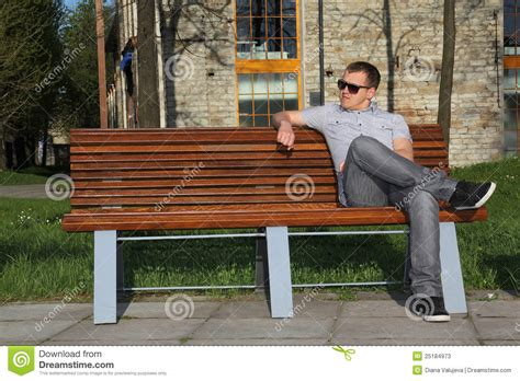 sitting the bench man sitting in park on the bench stock photos image 25184973