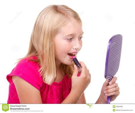 portrait of teenage girl putting lipstick on while looking at her young teen putting on lipstick stock photo image 26292386