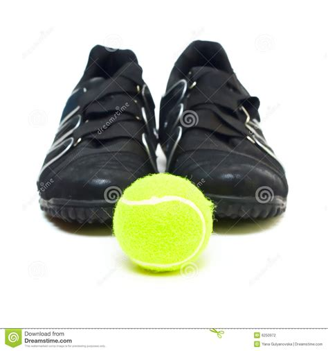 balls sports shoes black sport shoes and isolated on white stock