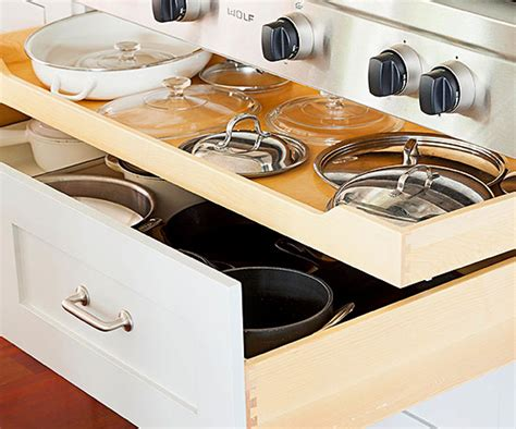 Organize Kitchen Cabinets And Drawers how to organize kitchen cabinets sliding shelves