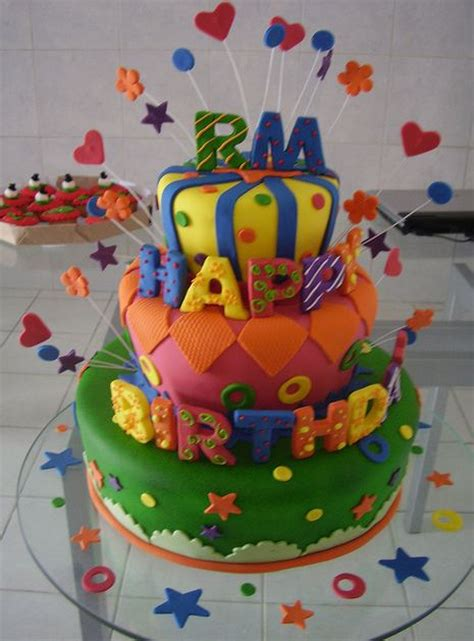 Three Tier  Ee  Birthday Ee   Cake Withlorful Letters And Stars