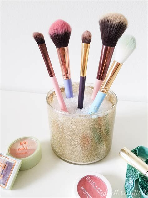 dwell beautiful shows you how to reuse candle jars and wax how to create a diy makeup brush holder from an old candle