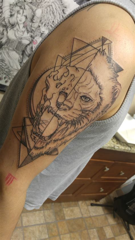 geometric lion tattoo skinhouse studio