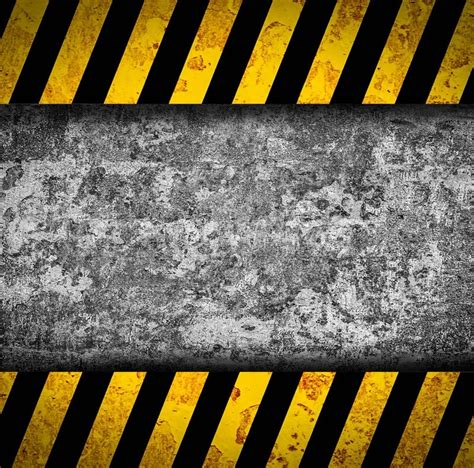 yellow warning pattern grunge metal background with black and yellow warning