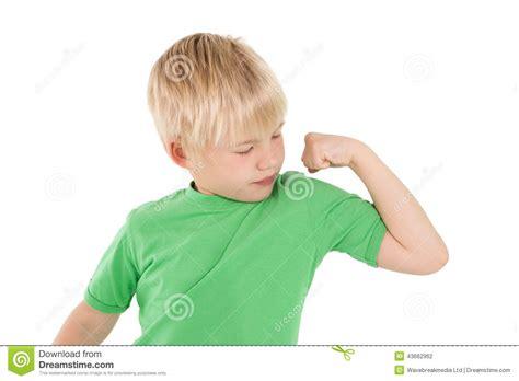 little boy flexing bicep cute little boy flexing his arm stock photo image 43662962
