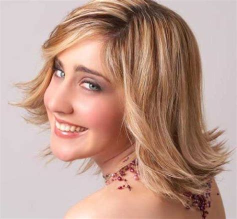 flipped up hairstyles pictures of medium length layered flipped out haircuts