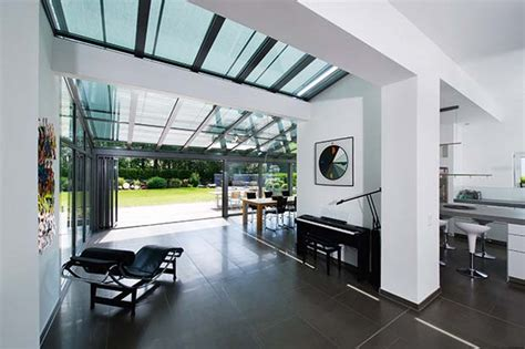 an iron roof and all glass walls how to add a sunroom homebuilding renovating