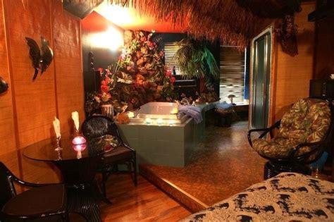themed hotel rooms winnipeg hawaii suite lava rock surround the large hot tub plan