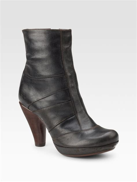 chie mihara stacked heel ankle boots in brown brown