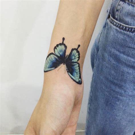tattoo on right wrist blue butterfly tattoo on the right wrist tattoo artist
