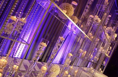 Crystal stage design with floating candles and touches of