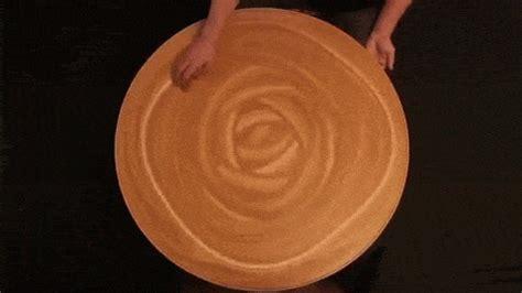 holding pattern gif mikhail sadovnikov creates hypnotic patterns on clay using