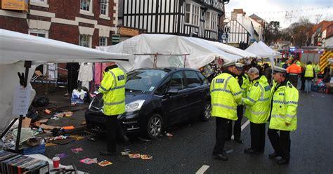 car crash south wales eight injured as car crashes into stalls at mold market wales