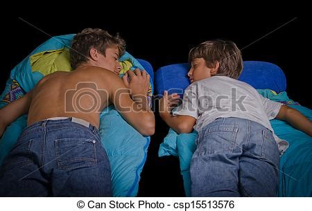 picture of two young boys sleep on sleeping bag