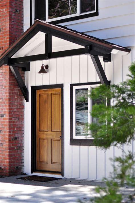 white  black trim solid wood door lake house