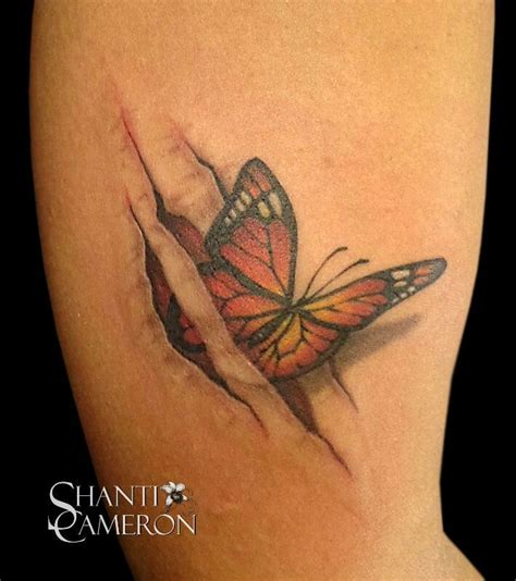 butterfly through ripped skin tattoo tattoos pinterest