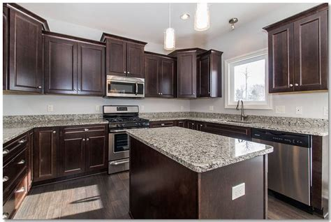 traditional kitchen stainless steel appliances granite traditional kitchen with espresso cabinets and granite